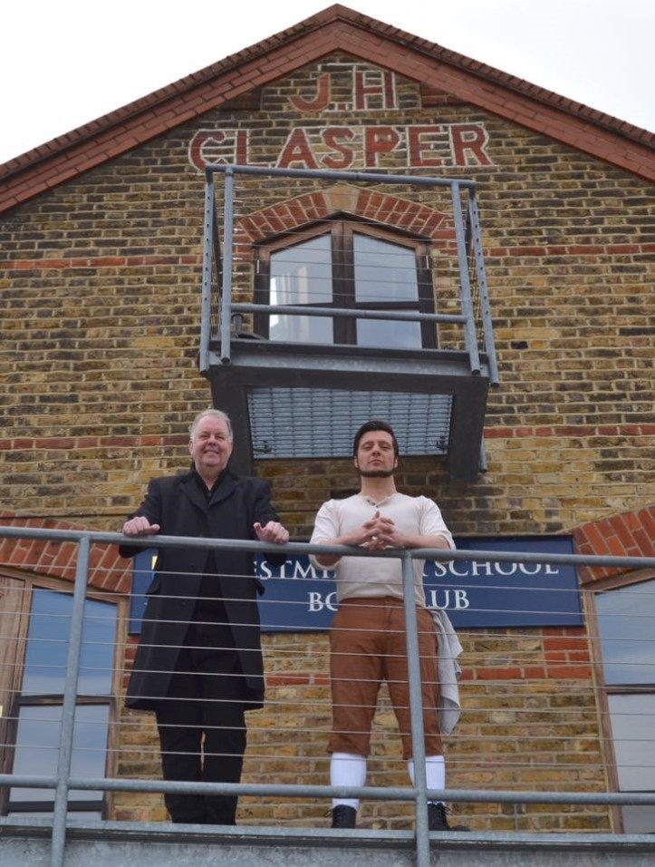 Ed Waugh and Jamie Brown on the balcony of Westminster School Boat Club under the iconic John Hawks Clasper sign. JHC was Harry's son and emigrated to London to set up his own boat building business. Photo: Tim Koch.