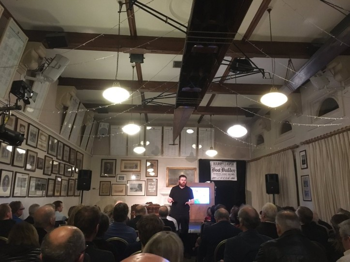 Keir Waugh, on stage in the bar of London Rowing Club, addressing the audience before the opening performance on Friday evening. Photo: Iain Weir @shutteritch.