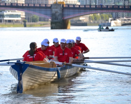 The Lords crew on the way to the start of the 2016 Parliamentary Boat Race. They are in a replica of the boat used by Oxford in the first University Boat Race in 1829.