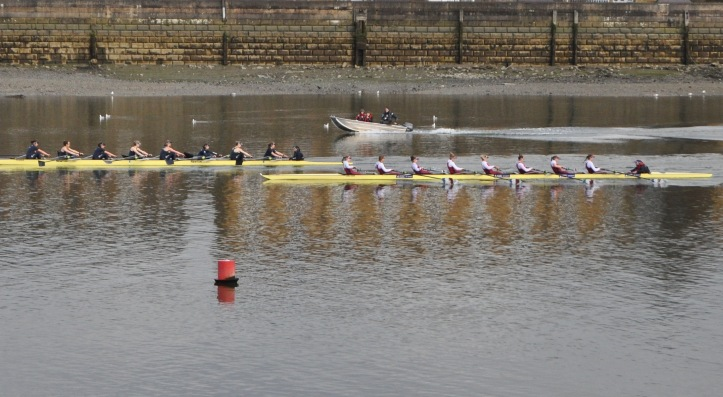 At the Mile Post. With no parallax error in the picture, the Oxford Women clearly lead by nearly a length.